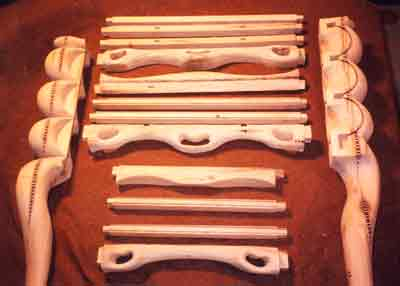 Image of several wooden cabinet parts.
