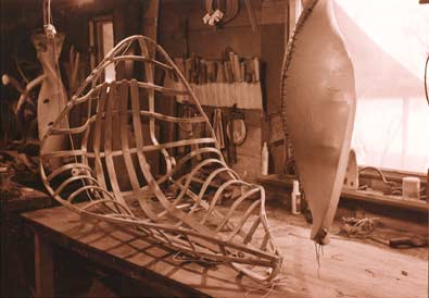 Image of Flying Boat hull awaiting skinning as paddles hang to dry